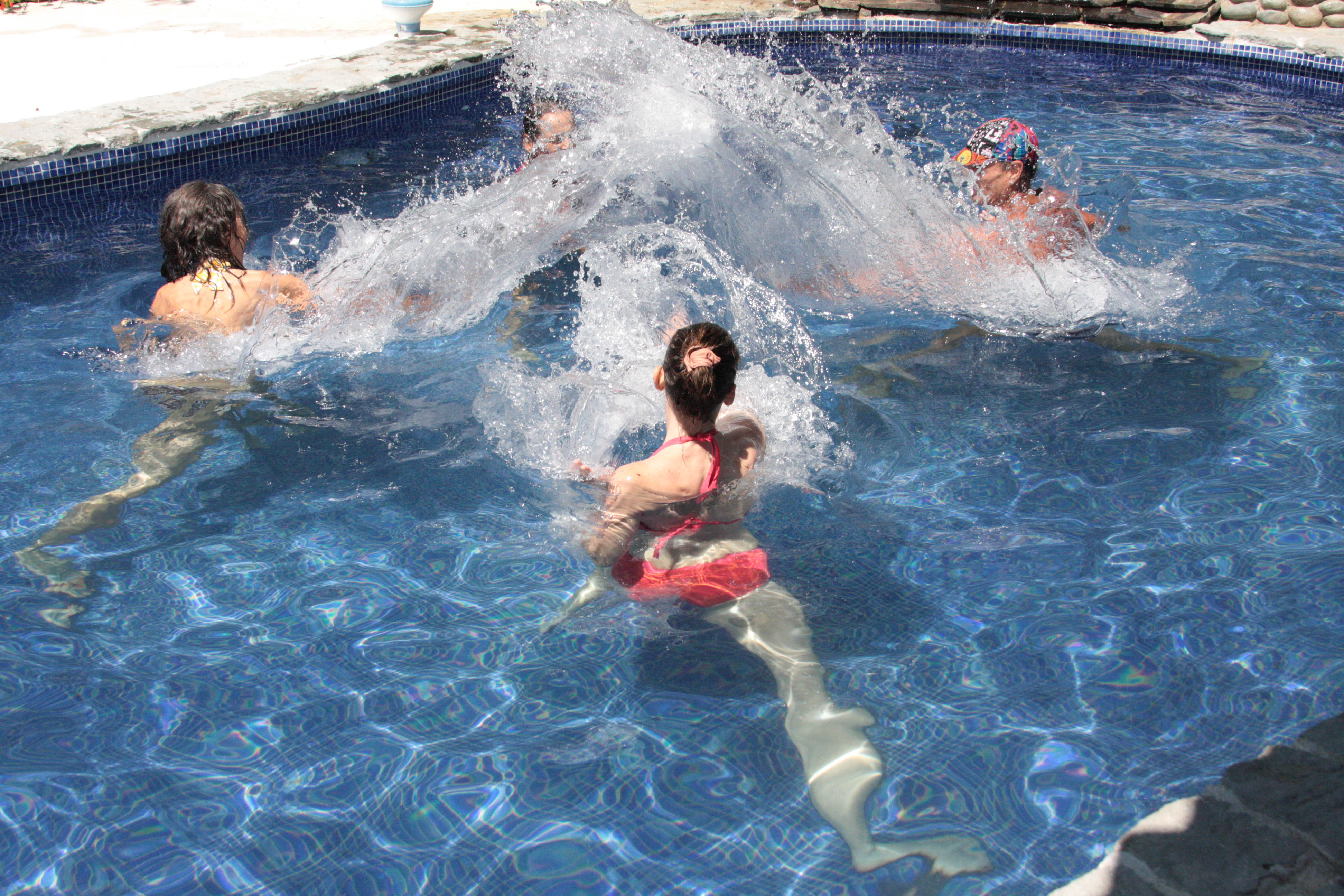 [Image:People Spash Exercise in Pool]